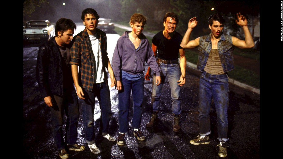 <strong>'The Outsiders':</strong> This 1983 Francis Ford Coppola-directed film -- based on the incredible coming-of-age novel by S. E. Hinton -- introduced the world to a new generation of Hollywood hotties: Emilio Estevez (from left), as Two-Bit Matthews, Rob Lowe as Sodapop Curtis, C. Thomas Howell as Ponyboy Curtis, Patrick Swayze as Darrel Curtis and Tom Cruise as Steve Randle.
