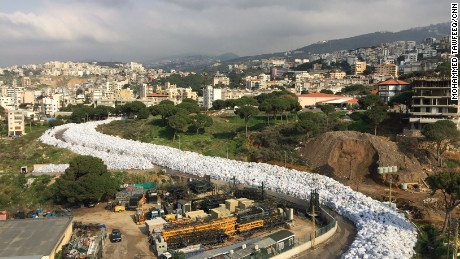 Piles of waste resemble a river of garbage in the Lebanese capital, Beirut on February 24, 2016.