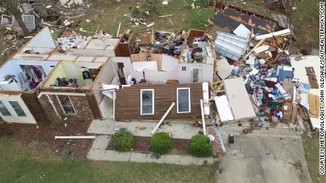 Pensacola apartment building damaged in tornado.