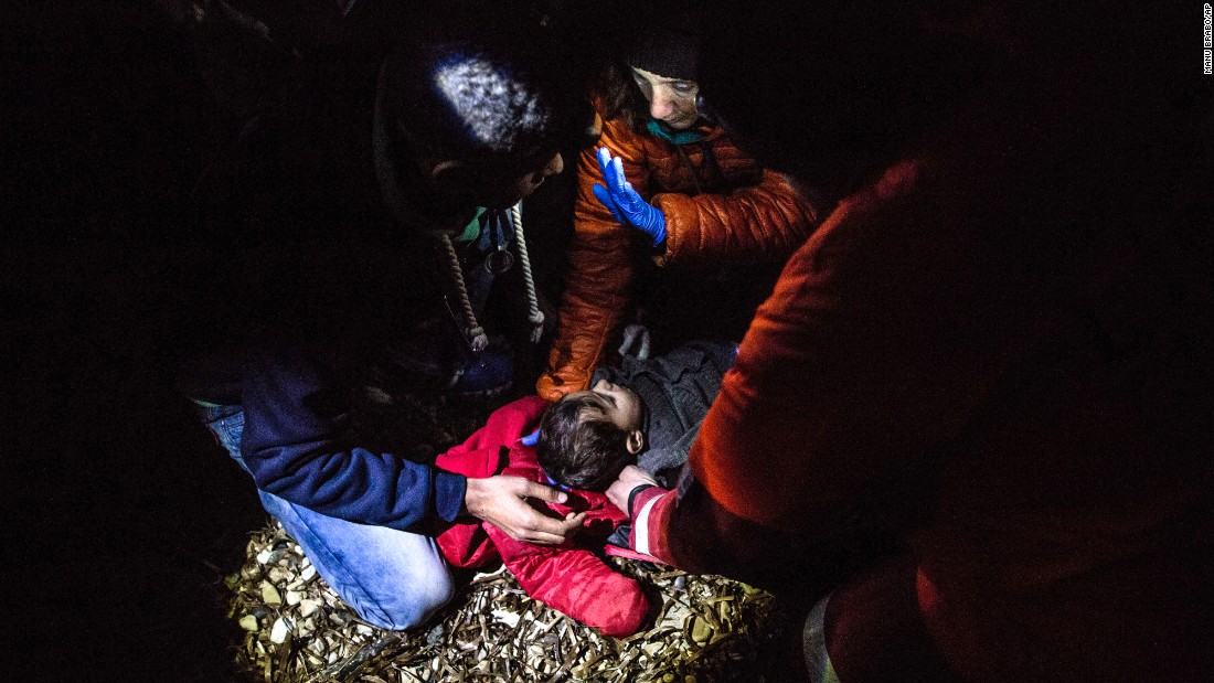 "A volunteer doctor examines a Syrian child who arrived with other migrants on the Greek island of Lesbos on Monday, February 22. <a href=""http://www.cnn.com/2015/09/03/world/gallery/europes-refugee-crisis/index.html"" target=""_blank"">See Europe's migration crisis in 25 photos</a>"
