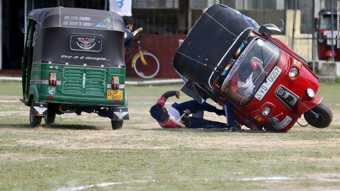 "A competitor falls out of his ""tuk tuk,"" a three-wheeled vehicle, during a polo game in Galle, Sri Lanka, on Sunday, February 21."