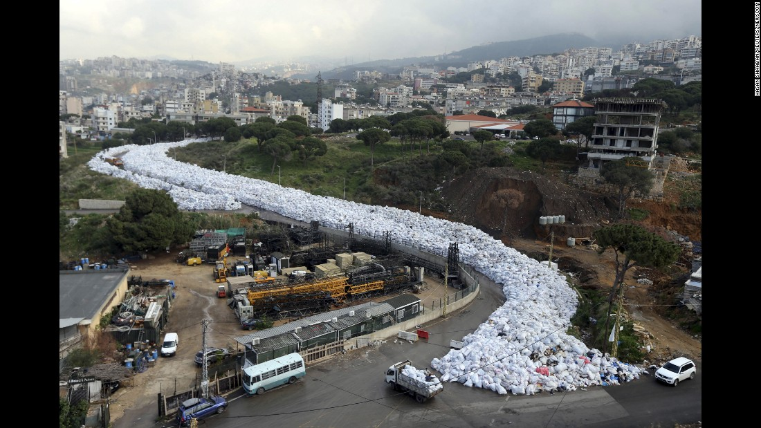 "Garbage bags snake their way through the suburbs of Beirut, Lebanon, on Tuesday, February 23. The overflowing landfill is a consequence of the city's <a href=""http://www.cnn.com/2016/02/24/middleeast/lebanon-garbage-crisis-river/"" target=""_blank"">garbage crisis. </a>"
