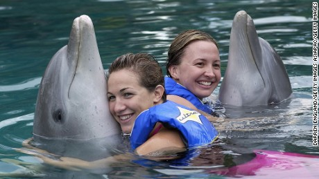 GOLD COAST - MAY 3:  Elka Graham and Brooke Hanson of the Telstra Dolphins Australian Swimming team swim with the dolphins on May 3, 2003 at Sea World on the Gold Coast, Australia. (Photo by Darren England/Getty Images)