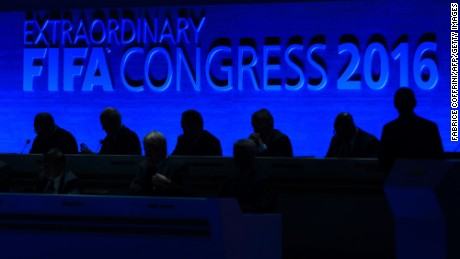 FIFA executive members are seen in silouette at the opening the FIFA electoral congress in Zurich on February 26, 2016. FIFA members will elect a new president and pass reforms they hope will open an escape route from a storm of scandal symbolised by the downfall of veteran leader Sepp Blatter. / AFP / FABRICE COFFRINI        (Photo credit should read FABRICE COFFRINI/AFP/Getty Images)