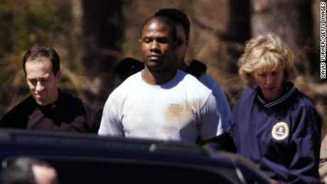 FBI agents escort murder suspect Brian Nichols from an FBI holding facility on March 12, 2005, in Atlanta, Georgia.