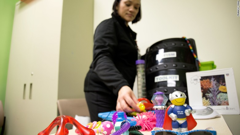 Eileen Walters sorts through some of the toys typically given to soothe children with special needs