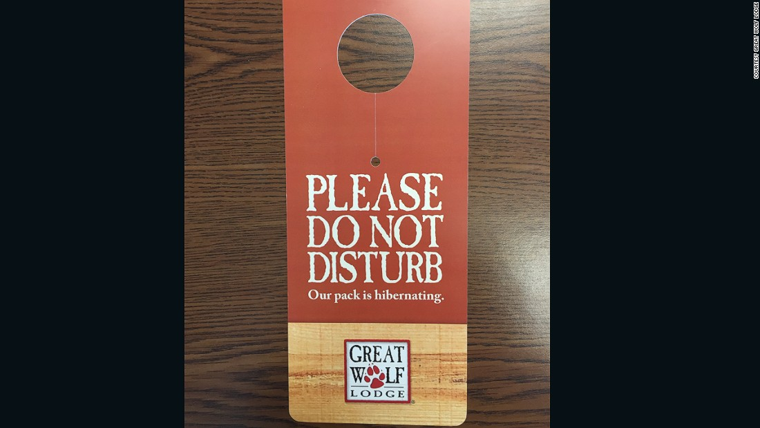 "Great Wolf Lodge, a chain of water park resorts throughout North America, pays homage to its ""rustic"" aesthetic and family fun with these wooden ""Do Not Disturb"" signs."