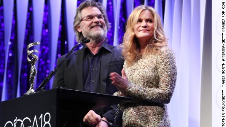 BEVERLY HILLS, CA - FEBRUARY 23:  Actors Kurt Russell (L) and Jennifer Jason Leigh speak onstage during the 18th Costume Designers Guild Awards with Presenting Sponsor LACOSTE at The Beverly Hilton Hotel on February 23, 2016 in Beverly Hills, California.  (Photo by Christopher Polk/Getty Images for CDG)
