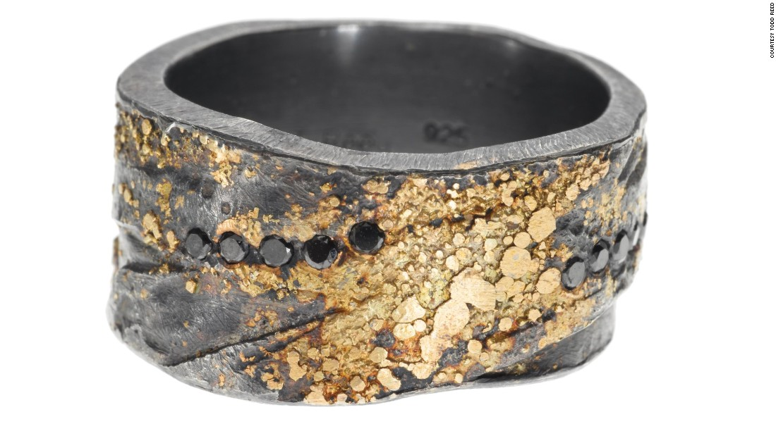 """This sterling silver and 22-karat gold band is hand fabricated by layer pieces of metal and hammering to create the texture of the band. It is a nice symbol of two people coming together to create a life together."" -- Todd Reed, CEO of<a href=""http://toddreed.com/"" target=""_blank""> Todd Reed </a>"