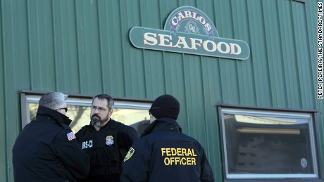 Federal agents raid the Carlos Seafood offices  in New Bedford, Massachusetts.
