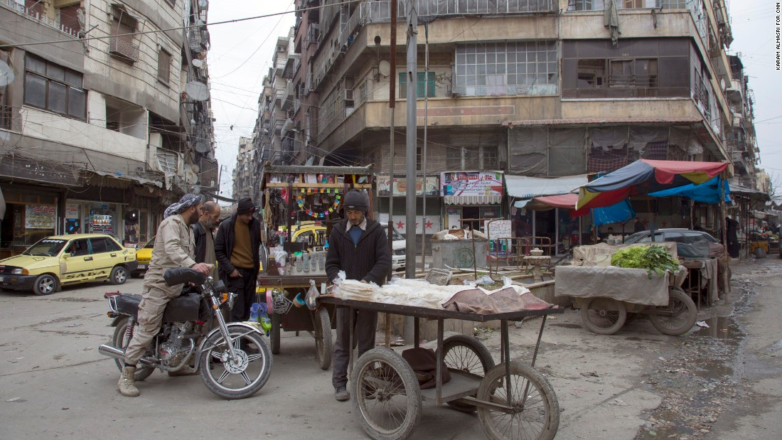Residents shot at a city market in Aleppo.