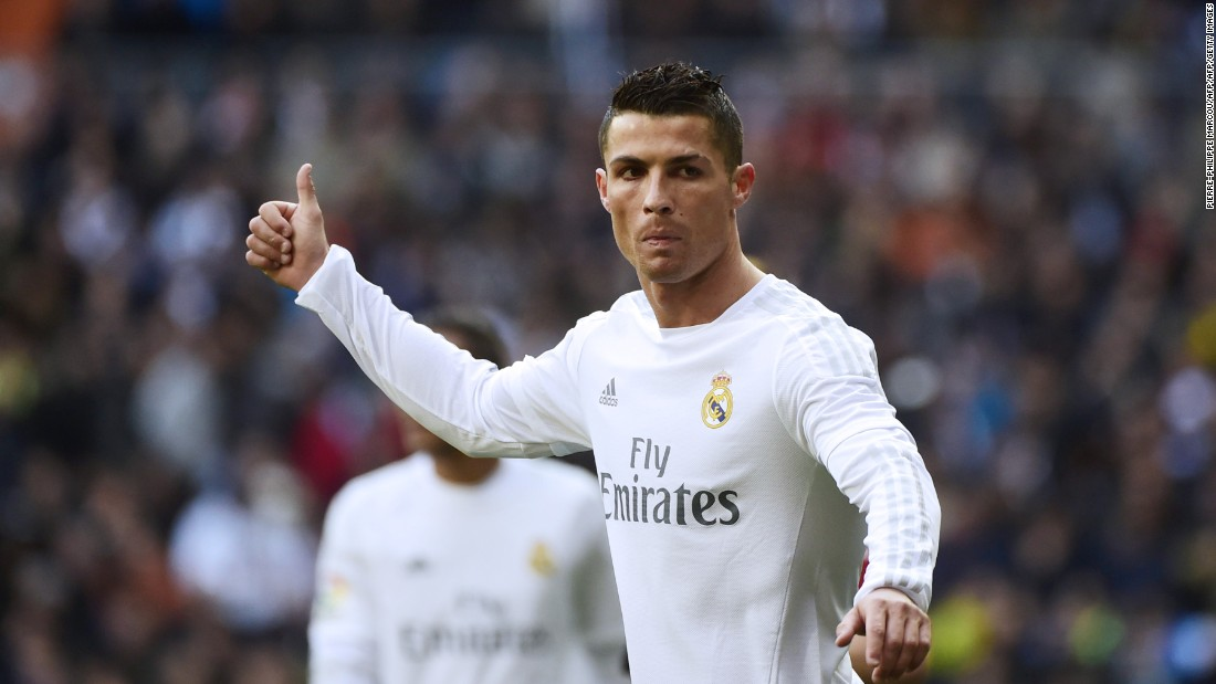 Ronaldo offers his praise to a teammate during Saturday's defeat  to crosstown rival Atletico Madrid.
