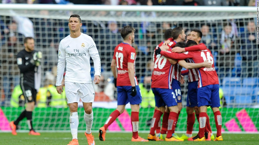 Atletico players celebrate on full time as Ronaldo walks away in frustration.