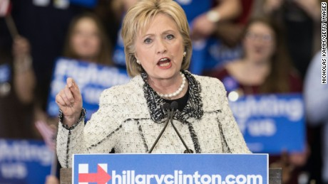 """US Democratic presidential candidate Hillary Clinton addresses a primary night rally in Columbia, South Carolina, on February 27, 2016, following her sweeping victory in the state's Democratic primary.  Hillary Clinton defeated Bernie Sanders by an overwhelming margin in Saturday's Democratic primary in South Carolina, projections showed, seizing momentum ahead of the most important day of the nomination race: next week's """"Super Tuesday"""" contests. / AFP / Nicholas Kamm        (Photo credit should read NICHOLAS KAMM/AFP/Getty Images)"""