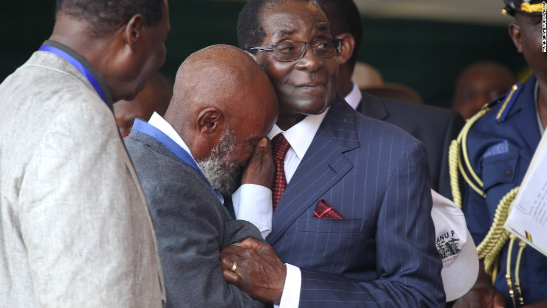 "A man cries as he greets him on February 27, 2016. Members of Zimbabwe's ruling party ZANU-PF called the president ""Dear Father"", ""His Royal Highness"" and ""the Moses of Africa."""