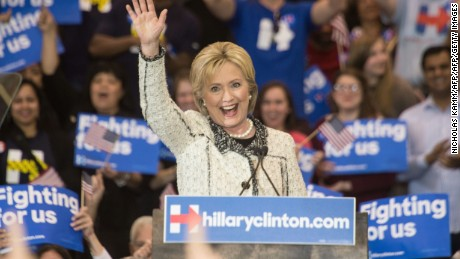 "US Democratic presidential candidate Hillary Clinton waves after addressing a primary night rally in Columbia, South Carolina, on February 27, 2016. Clinton defeated Bernie Sanders by an overwhelming margin in the Democratic primary in South Carolina, projections showed, seizing momentum ahead of the most important day of the nomination race: next week's ""Super Tuesday"" contests. / AFP / Nicholas Kamm        (Photo credit should read NICHOLAS KAMM/AFP/Getty Images)"
