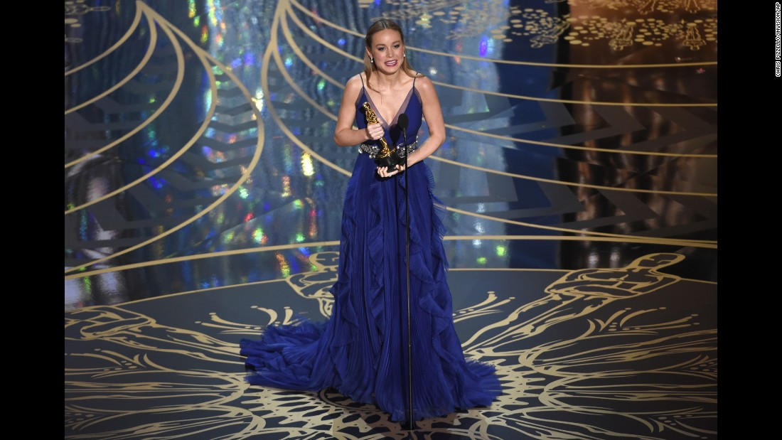 "Brie Larson accepts the best actress award for her role in ""Room."" She portrayed a woman held captive with her young son."