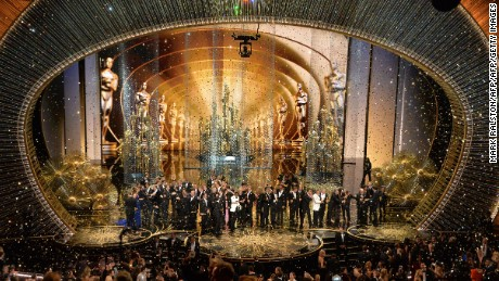 The production team and cast of Spotlight celebrate the award for Best Picture on stage at the 88th Oscars on February 28, 2016 in Hollywood, California. AFP PHOTO / MARK RALSTON / AFP / MARK RALSTON        (Photo credit should read MARK RALSTON/AFP/Getty Images)