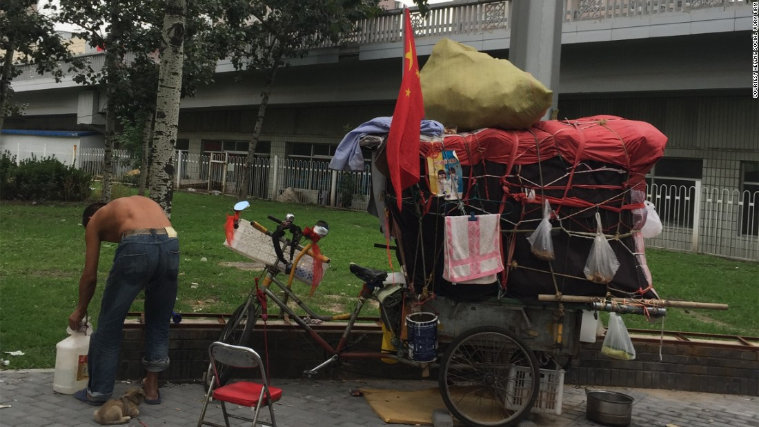 Social workers estimate that about 4,000 homeless people camp out on streets, in parks, under bridges in central Beijing.