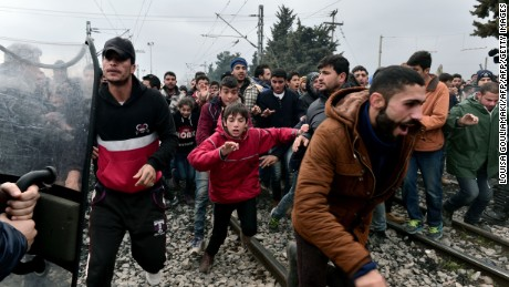 Migrants break through a blockade near the Greek-Macedonian border.
