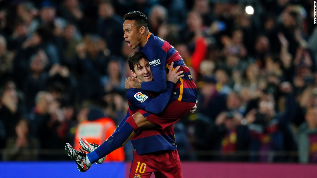 Lionel Messi holds his Barcelona teammate, Neymar, after scoring against Sevilla on Sunday, February 28. It was Messi's 30th goal of the season for Barcelona, which took an eight-point lead in the Spanish league.