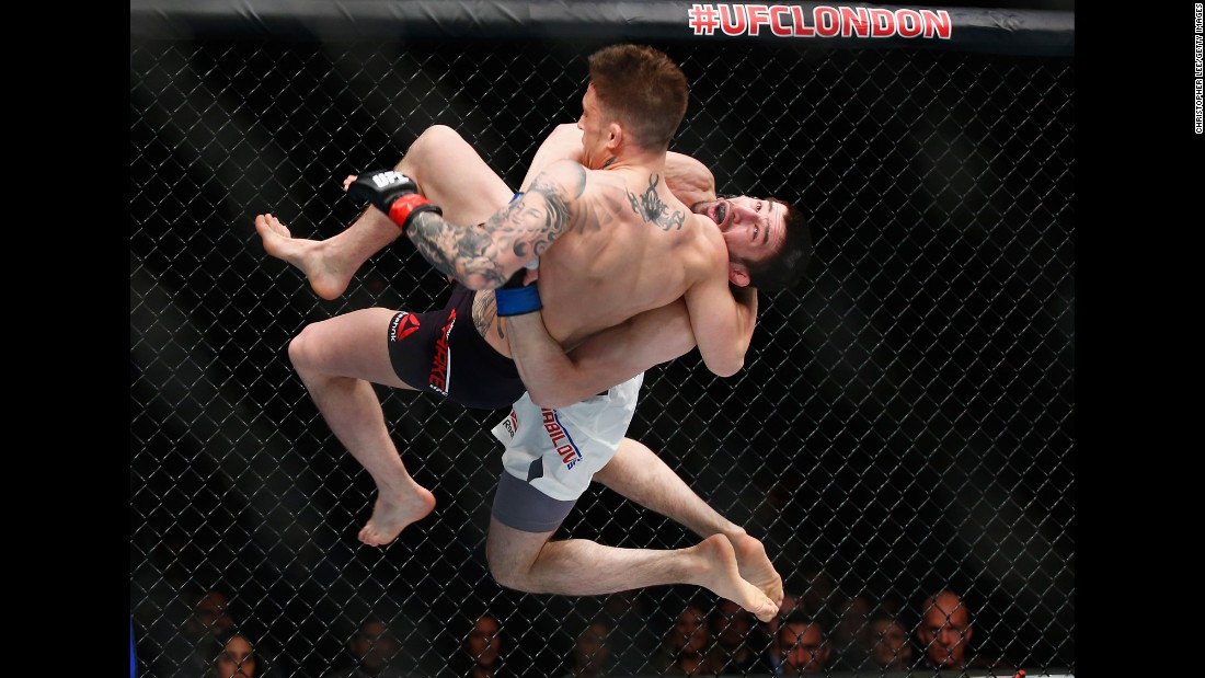 Rustam Khabilov (black shorts) throws Norman Parke during a UFC bout in London on Saturday, February 27. Khabilov won by unanimous decision.