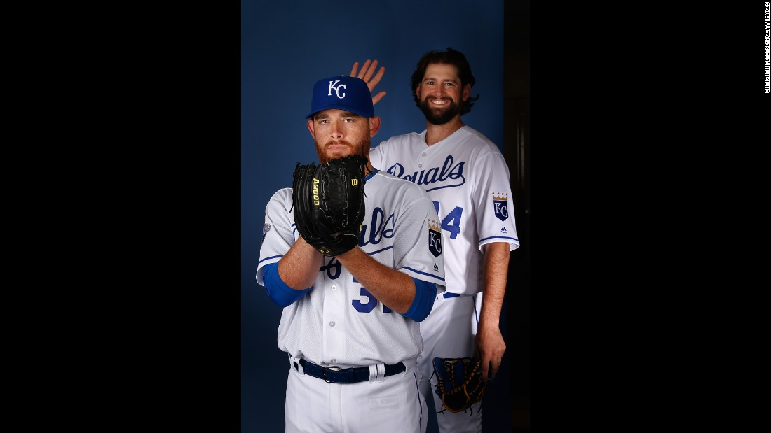 Luke Hochevar crashes Ian Kennedy's portrait during spring training photo day on Wednesday, February 25. Both play for the Kansas City Royals, who won the World Series last year.