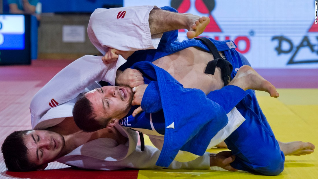 Russia's Aslan Lappinagov, left, grabs Czech opponent Jaromir Musil during the European Open judo tournament on Sunday, February 28. Musil won the match and went on to finish second in their weight class.