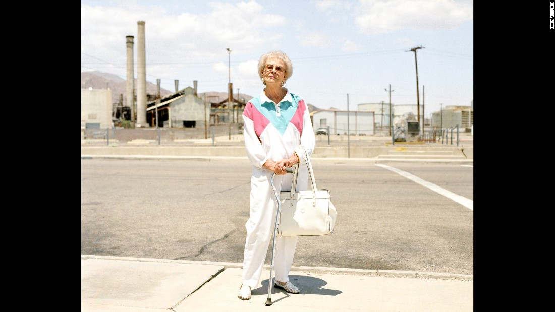 Alice Jones stands outside a mineral processing facility in Trona, California. More than 100 years ago, Trona was designed to house the workforce of a mining company. Its population, which once peaked at around 7,000, has now dropped to about 1,000, photographer Ewan Telford said.