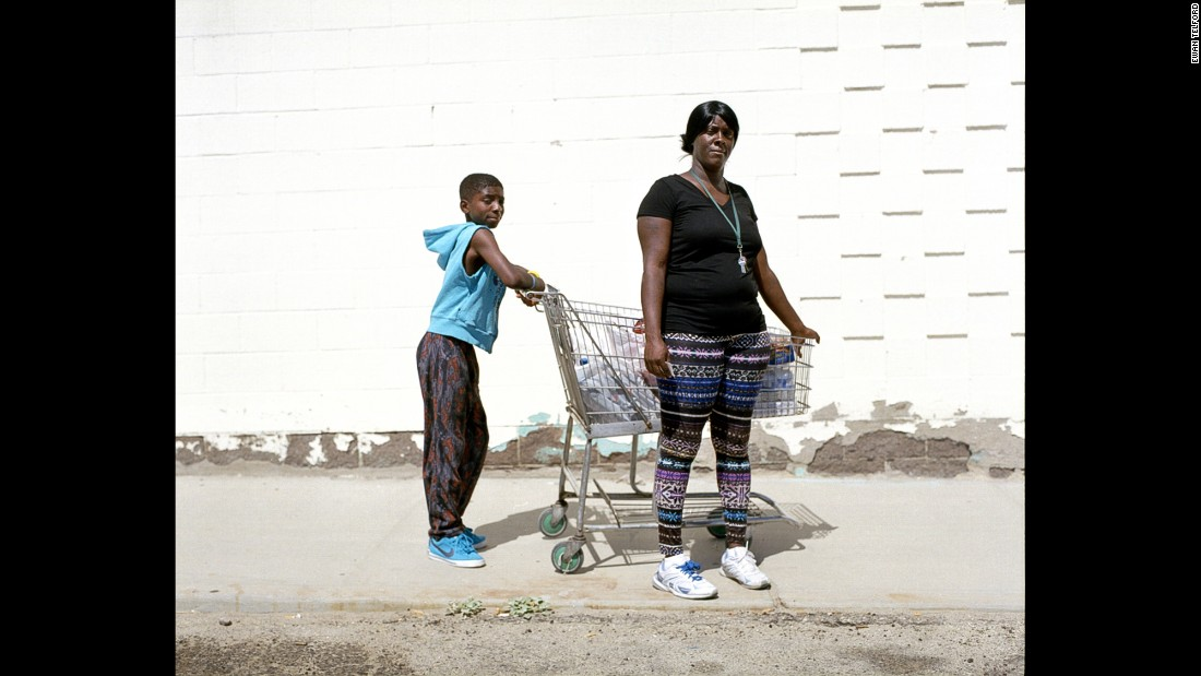 Trona resident Fellicia shops at the local store with her son Kevin.