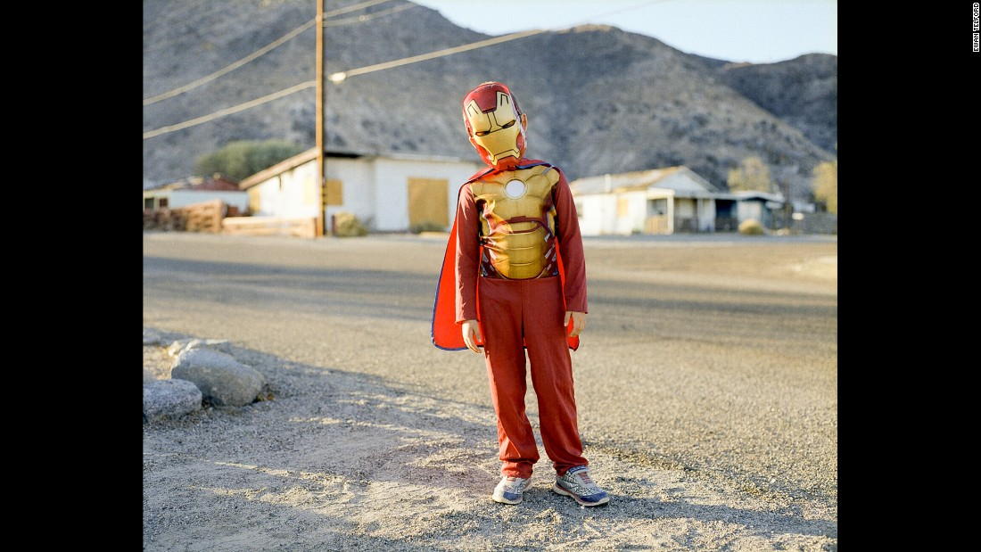 A boy wears an Iron Man costume.