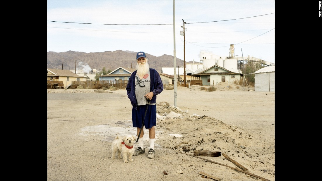 Ronny walks his dog through Trona.