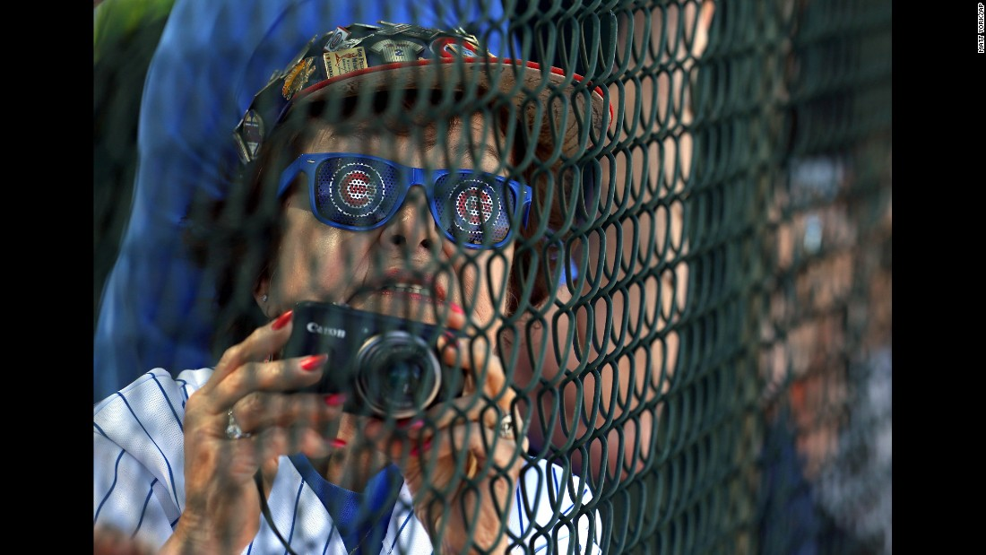 A Chicago Cubs fan watches the team practice in Mesa, Arizona, on Wednesday, February 24.