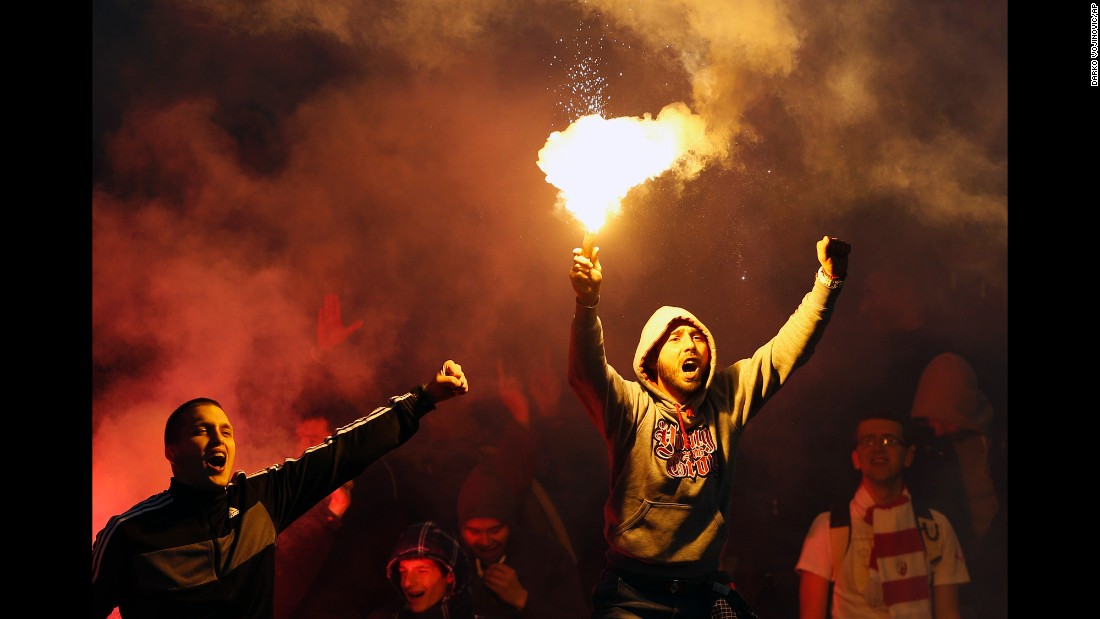 Fans of Red Star Belgrade cheer the Serbian soccer team during its derby match against Partizan on Saturday, February 27.