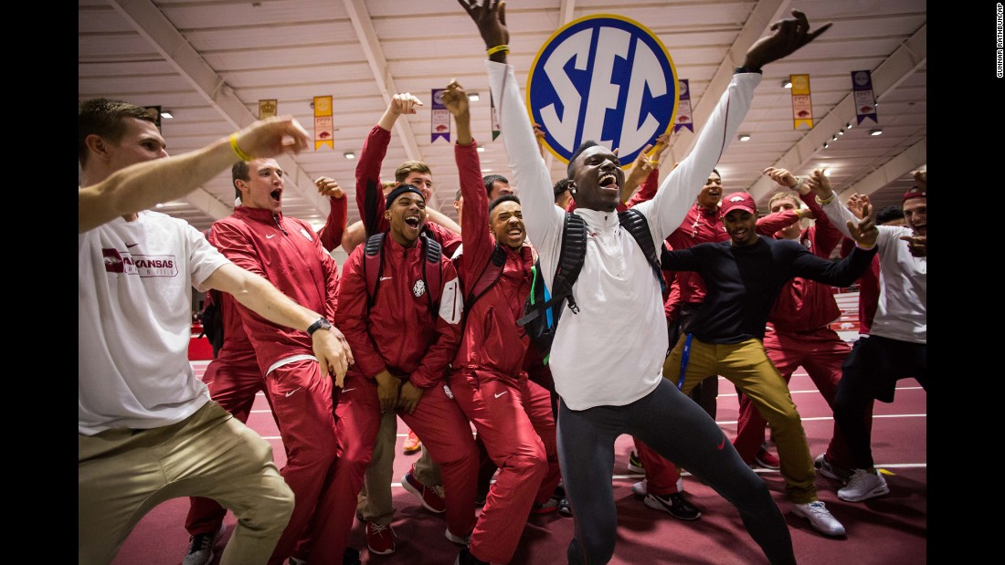 Track athletes from the University of Arkansas celebrate after they won the SEC indoor championships on Saturday, February 27. It is the 100th conference title in program history.