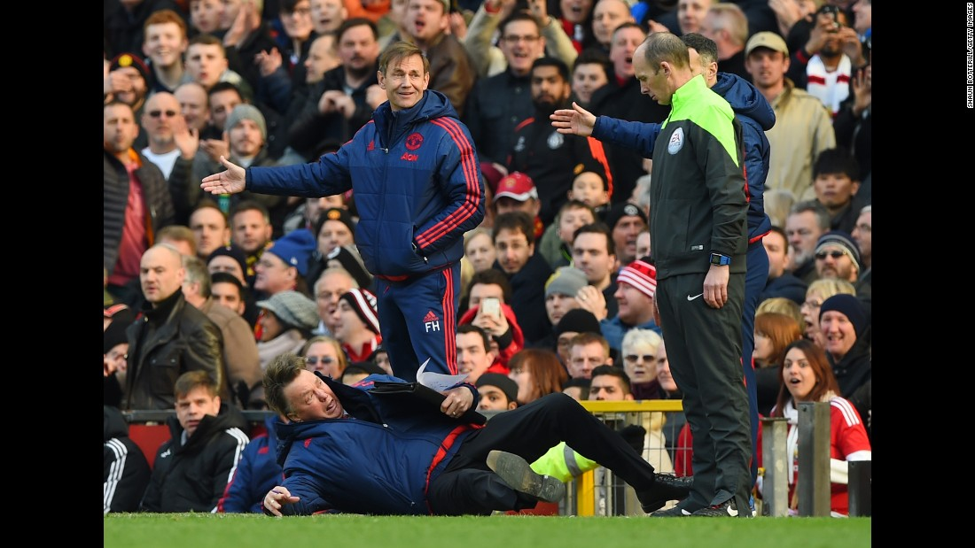 "Louis van Gaal, the manager of Manchester United, <a href=""http://bleacherreport.com/articles/2620431-manchester-united-vs-arsenal-louis-van-gaal-arsene-wenger-post-match-reaction"" target=""_blank"">throws himself to the ground</a> as he makes a point to the fourth official in Manchester, England, on Sunday, February 28."