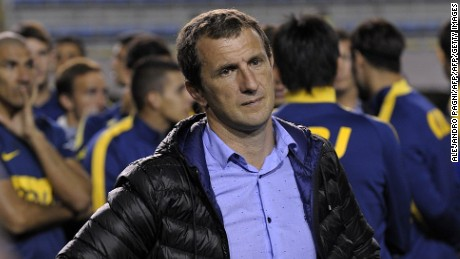 Argentina's Boca Juniors team coach Rodolfo Arruabarrena (C) and footballers react after the match was suspended when Boca Juniors' fans pepper sprayed River Plate players before the start of the second half of the Copa Libertadores 2015 round before the quarterfinals second leg football match at La Bombonera stadium in Buenos Aires, Argentina, on May 14, 2015. AFP PHOTO / ALEJANDRO PAGNI        (Photo credit should read ALEJANDRO PAGNI/AFP/Getty Images)