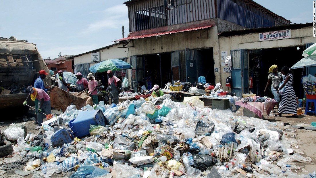 The government has slashed public spending in response to the oil crisis, leaving garbage uncollected in the streets of Luanda, which is contributing to a public health crisis.