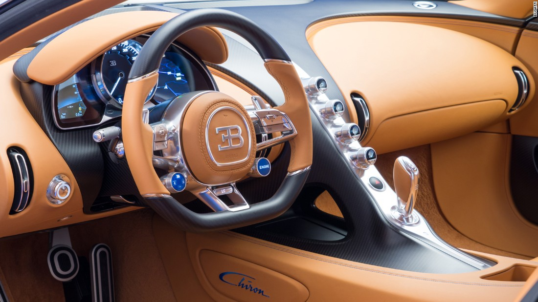 The cockpit layout of the Bugatti Chiron has a seven-speed dual-clutch gearbox. Produced from the most exclusive materials available, all aluminium parts are milled from solid material.