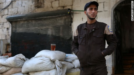 A member of the Syrian emergency personnel drinks tea at their center on February 29, 2016 in the Bab al-Nairab neighborhood of Syria's second city Aleppo on the second day of a landmark truce across parts of the country.