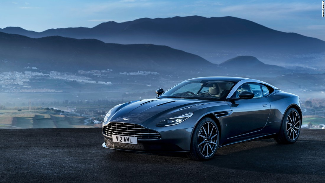 The brutally powerful V12 petrol engine sits underneath the sweptback bonnet and behind the Aston's trademark radiator grille.