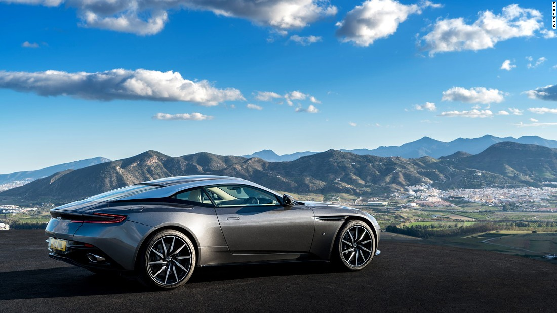 "The DB11 draws on a variety of aerodynamic tricks, including what Aston Martin call a ""curlicue,"" a curve beyond the front wheels, and an ""Aeroblade,"" an air channel beyond the door that ends below the boot lid, both creating downforce to keep the car firmly planted around corners."