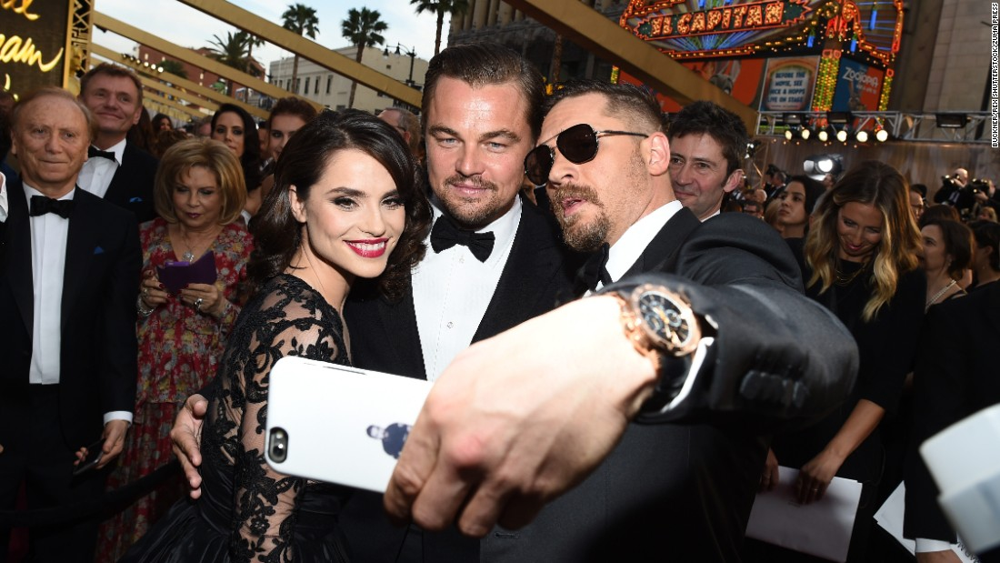 "Before the Academy Awards ceremony, actor Tom Hardy takes a selfie with his wife, Charlotte Riley, and his ""Revenant"" co-star Leonardo DiCaprio on Sunday, February 28. DiCaprio won the best-actor Oscar later that night. <a href=""http://www.cnn.com/2016/02/29/entertainment/gallery/oscars-winners-2016/index.html"" target=""_blank"">See all the winners</a>"