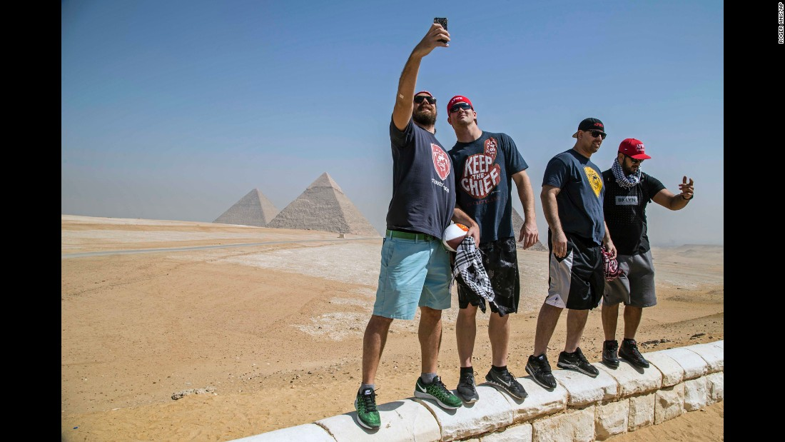 Pro football players visit pyramids during a trip to Egypt on Monday, February 29. They were with American Football Without Barriers, a nonprofit organization that educates disadvantaged children in the United States and overseas. From right is Oday Aboushi of the Houston Texans, Breno Giacomini of the New York Jets and Gary Barnidge of the Cleveland Browns. At far left is staff member Denny Somersan.
