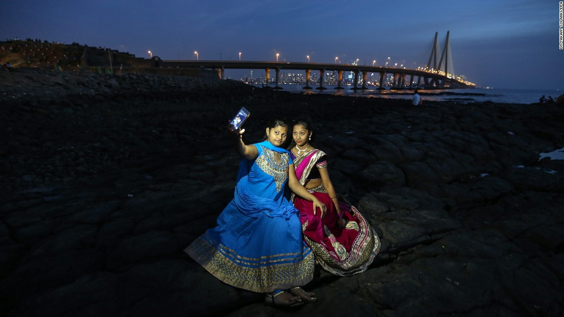 "People take selfies at the Bandra Fort bandstand, a famous tourist spot in Mumbai, India, on Thursday, February 25. <a href=""http://www.cnn.com/2016/02/24/living/gallery/look-at-me-selfies-0224/index.html"" target=""_blank"">See 27 selfies from last week</a>"