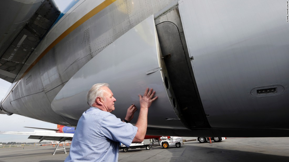 "Volunteer Jim Munneke closes a luggage compartment on the airliner that he helped restore. The 727 expanded air travel in the 1960s by allowing airlines to open shorter U.S. routes. Boeing manufactured 1,831 727s before the production line shut down in 1984. By 2003, all major U.S. airlines had retired the 727, <a href=""http://airwaysnews.com/"" target=""_blank"">AirwaysNews.com</a> reports. But a few still serve as freighters and VIP transports."