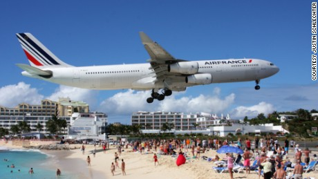This photo of an Air France Airbus A340 flying into Princess Juliana International Airport was taken at St. Maarten's Maho Beach.