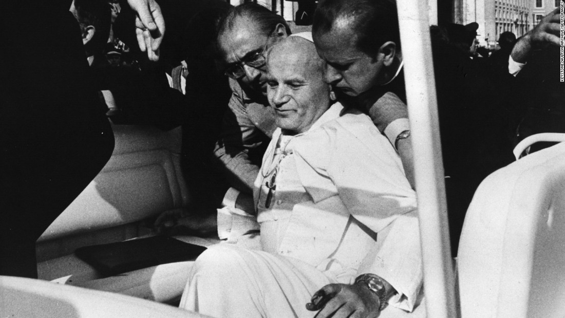 "<strong>Assassin targets Pope:</strong> Pope John Paul II collapses into the arms of his aides on May 13, 1981, after an <a href=""http://www.nytimes.com/learning/general/onthisday/big/0513.html#article"" target=""_blank"">assassination attempt</a> by Turkish terrorist Mehmet Ali Agca in St. Peter's Square. Struck by two bullets that hit his abdomen, right arm and left hand, the Pope was seriously wounded and underwent more than five hours of surgery to save his life. Agca went on to <a href=""http://www.theguardian.com/world/2010/jan/18/pope-john-paul-mehmet-agca"" target=""_blank"">serve 19 years</a> in an Italian prison. The Pope pardoned Agca in 1983 and worked for his eventual release."