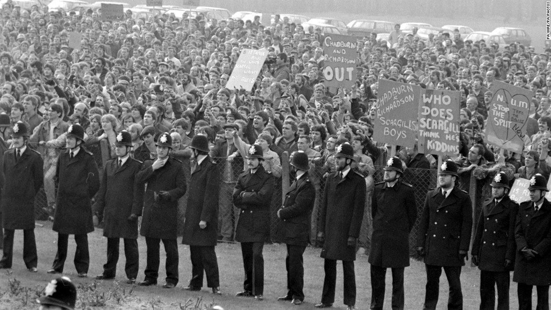 "<strong>Miners fight for right to work:</strong> Lines of policemen stand between two groups involved in a ""Right to Work"" rally during the 1984 miners strike in the United Kingdom. Mining unions began the yearlong strike -- with more than <a href=""http://www.bbc.co.uk/insideout/eastmidlands/series5/miners_strike_coal.shtml"" target=""_blank"">187,000 miners participating </a>-- as an attempt to stop the closing of coal pits. It's been called the longest industrial dispute of the 20th century."
