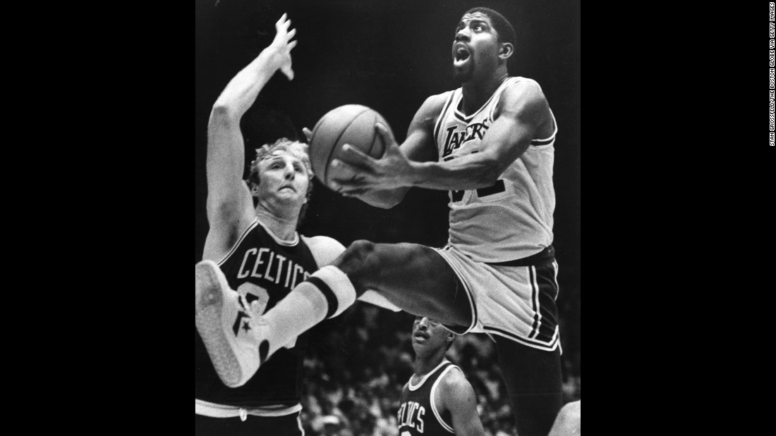 <strong>Rivalry reignited:</strong> Magic Johnson, right, and Larry Bird go head to head as the Los Angeles Lakers battle the Boston Celtics for the NBA title in June 1984. The seven-game playoff series, won by the Celtics, added fuel to a Johnson-Bird rivalry that went back to their college days.